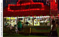 Candy Land, Winona Peach Festival (jwvraets) Tags: foodstand candyland winona hamilton winonapeachfestival night fallfair red redrule opensource rawtherapee gimp nikon d7100 nikkor35mmf18dx