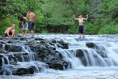 Playing In The River (Robert F. Carter) Tags: ocqueoc ocqueocriver ocqueocfalls waterfalls rivers rogerscity people boys play playing michigan landscape riverscapes landscapes robertcarterphotographycom ©robertcarter puremichigan ngc