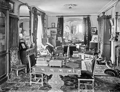 No drisheen in Drishane Castle but plenty of clutter! (National Library of Ireland on The Commons) Tags: robertfrench williamlawrence lawrencecollection lawrencephotographicstudio thelawrencephotographcollection glassnegative nationallibraryofireland drishanecastle ireland roominterior books pictures furniture fireguard drawingroom millstreet countycork convent drishaneconvent congregationofthesistersoftheholyinfantjesus infantjesussisters kellyshandbooktothetitledlandedandofficialclasses wallis directprovision