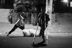 Just do not take their joy away.... (N A Y E E M) Tags: boys kids tokai beggar disabled crutches night light street crbroad chittagong bangladesh poverty children availablelight carwindow