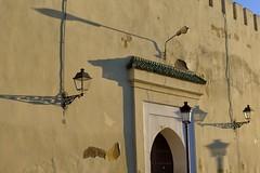 Shadow play (halifaxlight) Tags: morocco meknes fortifications walls door lamps shadows sunlight archway crennalatedwall