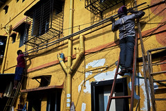 Yellow brick road (Mike Foo) Tags: india steet canon candid travel asia people workers mumbai bombay