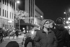 Looking over (LostOne1000) Tags: cedarrapids fireandice city people cold blackwhite iowa parade night unitedstates downtown us holidaydelightparade