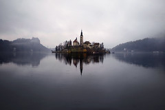 Reflective Surface (Don César) Tags: bled slovenia eslovenia europe europa lake lago see fog neblina hills colinas agua water island isla tower torre white blanco negro black wow brilliant iglesia church