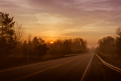 calle Este (Christian Collins) Tags: road calle este stained sunrise efs24mm canon t2i diamond drive midland mi east fog mist amanecer guardrail trees sun sunintrees