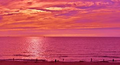 August Illusion (farmspeedracer) Tags: pink sunset red summer sky people orange cloud sun beach nature germany evening