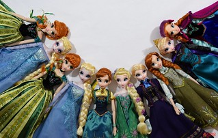 Anna and Elsa Put Their Heads Together - All Limited Edition Anna and Elsa 17'' Dolls by the Disney Store - Lying Down Side by Side - Midrange Front View