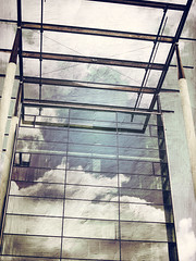 In Rotterdam, clouds reflected in the Architectural Institute using the photo app Stackables (elizabatz.jensen) Tags: clouds reflection mirror building photoapp geometric angles stackables architecturalinstitute