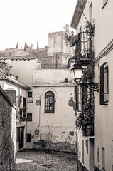 Calle Capellanes (ManuelHurtado) Tags: countries places spain alhambra alley ancient andalusia arabic architecture balcony building city cityscape europe european facade granada historic house lamp medieval monument neighborhood old quaint ruin spanish tourism tower traditional travel urban white