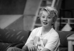 Happy nephew taking a well deserved break after a skating session (m3dborg) Tags: portrait portraits people boy skater bw black white indoor natural light bokeh depth field sony a77ii dt 50mm f14 monochrome