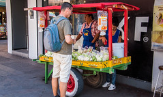 2016 - Mexico - San Luis Potosi - Jicama y Cucumber (Ted's photos - Returns late December) Tags: 2016 cropped mexico nikon nikond750 nikonfx sanluispotosi tedmcgrath tedsphotos tedsphotosmexico vignetting backpack male foodcart glasses streetscene street people vendor cart wheels canopy wheel
