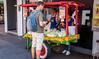 2016 - Mexico - San Luis Potosi - Jicama y Cucumber (Ted's photos - For Me & You) Tags: 2016 cropped mexico nikon nikond750 nikonfx sanluispotosi tedmcgrath tedsphotos tedsphotosmexico vignetting backpack male foodcart glasses streetscene street people vendor cart wheels canopy wheel