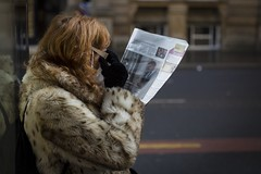 A Closer Look (Leanne Boulton) Tags: urban street candid portrait streetphotography candidstreetphotography candidportrait streetlife woman female old age face hidden glasses eyesight newspaper reading ginger redhead fur furry coat gloves winter weather warm sunlight cold tone texture detail depthoffield bokeh natural outdoor light shade shadow city scene human life living humanity people society culture fashion style canon 5d canon5dmkiii colour color 70mm character ef2470mmf28liiusm glasgow scotland uk