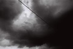 Dark heavy clouds (Mambo Ferido) Tags: leica sky blackandwhite film clouds analog kodak voigtlander trix feel 1600 kodaktrix emotions m4 shadesofblue pushedfilm