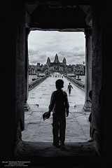 In the gate at Angkor Wat (Aslak - over 500.000 views :)) Tags: travel boy summer people blackandwhite bw canon season lens photography photo blackwhite asia cambodia foto khmer time sommer august angkorwat type dslr siemreap angkor tid region province kamera eos20d tempel fotografering angkorvat kambodsja objektiv khmerempire rstid khaet sigmaex1020mm1456dchsm