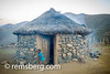 Young boy running out of the front of a village hut in Lesotho, Africa (Remsberg Photos) Tags: world africa travel usa mountains outdoors village child running wanderlust adventure hut lesotho remotelocation thatchroof stonematerial yooungboy world|africa
