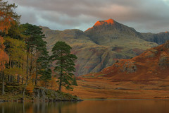 Last Light on the Langdale Pikes (Andy Watson1) Tags: lastlight langdale pikes blea tarn lake district national park cumbria england english uk united kingdom great britain british light shadow golden hour landscape view scene scenic scenery countryside mountains side pike harrison stickle water nature november autumn autumnal fall canon 70d sunlight sunshine sunlit sunset orange red yellow green blue brown clouds cloudy sky mountain evening lakeland tree trees woodland reflection central travel trip hike hiking walk walking bright weather depthoffield lighting serene peaceful