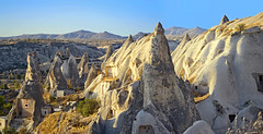 (marozn) Tags: anatolian anatolia famous mountain travel rock outdoor hill adventure stone view landscape beautifully turkey nature mountains cappadocia goreme valley village ancient geological geology kapadokya background rural scenic season sunny seasonal sunlight formation cliffs caves architecture houses house mushroom evening sunset formations exterior sunrise sandstone homehouses