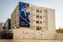 (Dubai Jeffrey) Tags: 2december dubai advertisement apartment billboard children emirati jaffiliya play street television traditional urbanart wall
