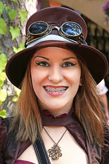Steampunk Beauty (wyojones) Tags: texas texasrenaissancefestival toddmission texasrenfest renfest renfaire renaissancefaire faire renaissancefestival festival trf girl woman brunette maiden steampunk cute pretty lovely gorgeous beautiful beauty browneyes lips braces retainer smile silversmile hat goggles