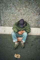 (michel nguie) Tags: michelnguie film analog vertical man cap sit street wall bordeaux burdigala bx mriadeck auchan begging money coins hands shoes jeans sleep