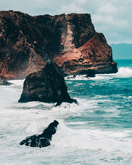 Volcanic Rock Cliff (noberson) Tags: rock rocks volcanic volcano cliff ocean sea coast madeira travel outdoor landscape red blue water waves