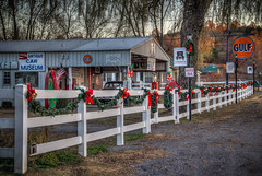 Antique Car Museum (donnieking1811) Tags: tennessee granville antiquecarmuseum lights redbows garland gulf cocacola whitefence building buildings tree trees outdoors canon 60d