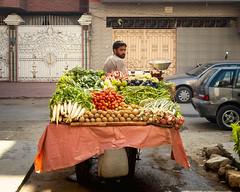 Get your winter vegetables (Fortunes2011.) Tags: fortunes2011nikond80 street streetphotography food freshfood vegetables seller vendor cart salesman doortodoor salad greens