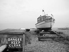 Sally Joy, Deal beach (Hammerhead27) Tags: old sea england sky blackandwhite beach water danger mono boat kent junk shingle dry pebble deal land wreck