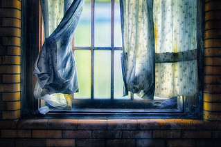 Window With Sad Curtains