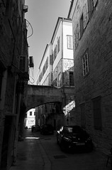 partially sunny (k0syak) Tags: sky urban house building brick window car stone wall architecture israel pavement drain shutters oldcity acre acco bwblackandwhite sonynex5 sel1855 sel1855f3556oss