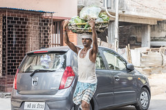 Man Carrying Lettuce (rjsnyc2) Tags: city travel india holiday nikon asia day celebration kolkata puja calcutta durgapuja travelphotography d810 richardsilver travelphotographer nikond810 richardsilverphoto richardsilverphotography