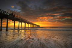 Scripps Pier Sunset (David Colombo Photography) Tags: lajolla scrippspier sunset california landscape seascape sky clouds sun orange red waves sea ocean pacific nikon d800 davidcolombo davidcolombophotography outdoor pier vibrant color