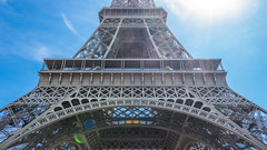 Names on Eiffel Tower (paradycedesign) Tags: sky city sunset street travel blue sun light clouds europe tower tourism urban architecture summer building lens flare paris france eiffel names la tour eiffelturm îledefrance