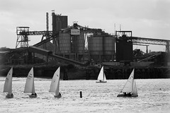 leisure and recreation in Dystopian style (lunaryuna) Tags: lake plant factory tarmacfactory sailboats urbanrecreation urbanlandscape blackwhite bw monochrome slidesfromdystopia lunaryuna