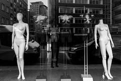 Kiosk (Gary Kinsman) Tags: london e1 eastlondon eastend greenfieldroad whitechapel canoneos5dmarkii canon5dmkii canon24105mmf4l bw blackwhite mannequin kiosk shop shopfront window glass reflection layers cityfringe