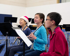 CL20151211-004.jpg (Menlo Photo Bank) Tags: singing athleticcenter 2015 holidayassembly fall boy menloschool hat arts middleschool event girls flute orchestra smallgroup people performance music photobycyruslowe students atherton ca usa us gym