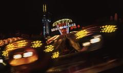 spinning lights (greendarkroom) Tags: agfact diafilm greendarkroom munichatnight mnchen oktoberfest scans wiesn2016 lights bokeh fair people sunset light black blue munich cultur germany night