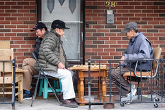 #43/52 Chinatown porch Xiangqi among old friends (PJMixer) Tags: 52weekproject chinatown downtown fuji toronto dogwood52 dogwoodweek43 elderly family game people porch