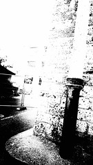 Down the drain (newshot.) Tags: sony xperiaz5 cellphone smartphone falkland mill fife demolition abandoned highcontrast texture grain abstraction tilt compositionalline massing shapes drainpipe plinth brickwork blacks patterns