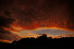 """The Passing Storm"" (Melissa June Daniels) Tags: storm stormchasing noaa skywarn nature landscape hdr melissajdaniels melissajunedaniels melissajdanielsphotography thenymphandthebee mjdphoto treeline field mammatus cloudsstormssunsetssunrises cloud clouds weather wx planet colors pink sunset"