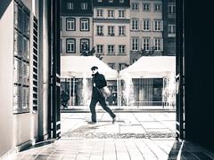 In a hurry (Lasorigin) Tags: eau magasin strasbourg street sujet urbanpicture city windows building shadow blackwhite bw door sunlight sun water shop people dark tent chapiteau box bote pavment pav square carr pierre stone canon eos 100d 50mm