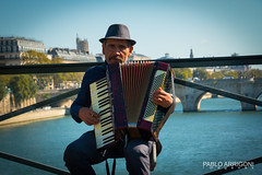 Music at the Sena (Pablo Arrigoni) Tags: music musician musica musico sena france francia river rio bridge puente outside outdoor europe europa water agua color colors colores colours eos eos70d 18135 canon accordion acorden instrumento persona people old viejo alone solo hat sombrero player intrprete
