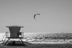 Huntington Beach, CA (Jose Matutina) Tags: ocean california sea water sport unitedstates pacific surfer kitesurfing orangecounty huntingtonbeach kitesurfer lifeguardstation sel55210 sonyalpha6000 sonya6000
