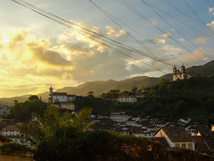 Ouro Preto 1 (D Song) Tags: old city travel blue sunset brazil sky panorama playing mountains streets green heritage church architecture kids buildings children churches panoramic historic unesco cobblestone vista belohorizonte hilly favela ouropreto slums