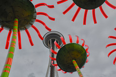 Blooming Needle (Ken Cruz --- Fernweh) Tags: seattle flowers red sky abstract building chihuly art monument architecture buildings colorful neon cloudy famous landmark installation sunflower bloom pacificnorthwest spaceneedle washingtonstate hdr blooming neongreen upshot pioneerpark
