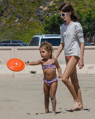 You throw it like this... (Kevin MG) Tags: ocean ca girls usa cute beach water youth outdoors losangeles sand pretty little young malibu zuma bikini zumabeach 500px