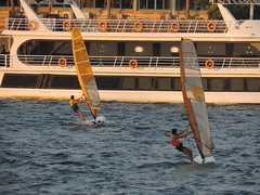 Action (Khaled M. K. HEGAZY) Tags: blue red orange brown white black green nature water yellow closeup river boat nikon outdoor egypt nile surfboard coolpix sail windsurfing giza straightoutofthecamera شراع sooc قارب p520 نهرالنيل