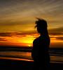 Escrever o futuro (JoFigueira) Tags: silhueta silhouette mulher woman gravidez pregnancy sol sun pôrdosol sunset poente entardecer dusk praia beach mar sea sand areia céu sky clouds núvens portugal guincho praiadoguincho contraste contrast vento wind