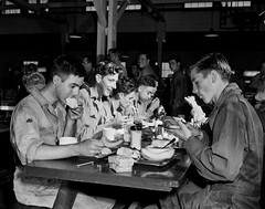 Des Moines Register Collection0448.jpg (The Digital Shoebox) Tags: sheetfilm desmoinesregister madeinusa teenagers epsonv700 iowa original group foundfilm monochrome uniform food jumpsuit eating memories scan breakfast found blackandwhite ebay meal desmoines boys kodak